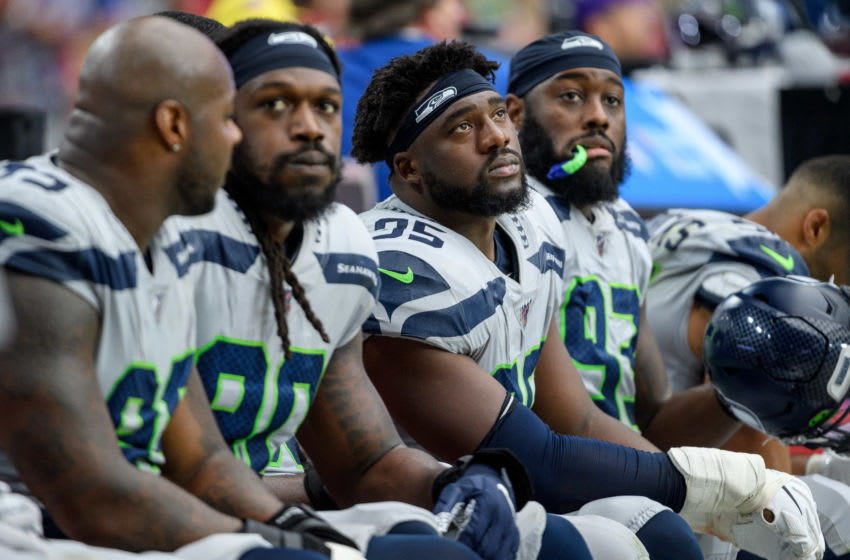 GLENDALE, ARIZONA - SEPTEMBER 29: Defensive end L.J. Collier #95 of the Seattle Seahawks reacts on the bench alongside teammates during the NFL game against the Arizona Cardinals at State Farm Stadium on September 29, 2019 in Glendale, Arizona. The Seahawks won 27 to 10. (Photo by Jennifer Stewart/Getty Images)