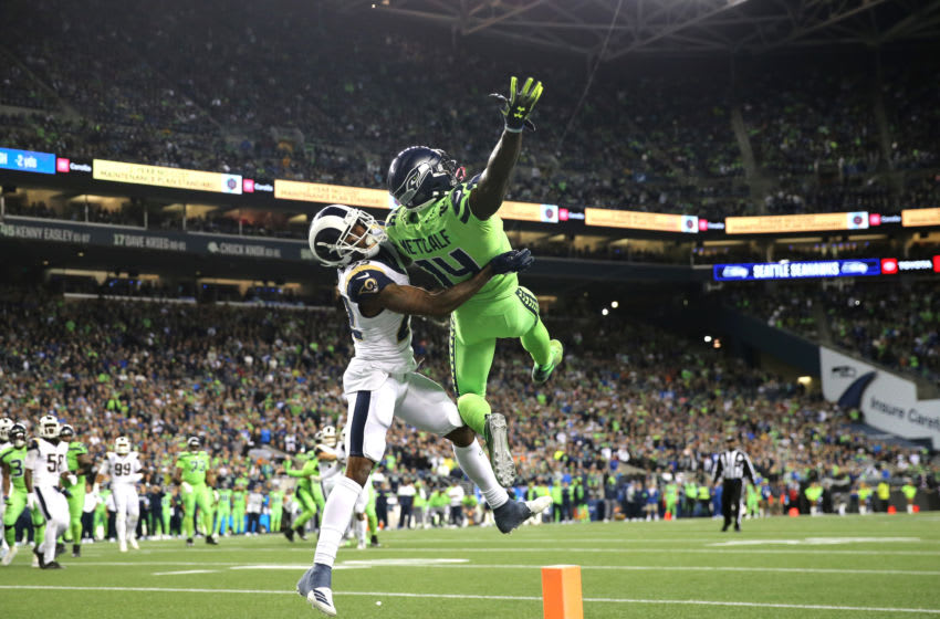 SEATTLE, WASHINGTON - OCTOBER 03: D.K. Metcalf #14 of the Seattle Seahawks reaches for an incomplete pass against Marcus Peters #22 of the Los Angeles Rams in the fourth quarter during their game at CenturyLink Field on October 03, 2019 in Seattle, Washington. (Photo by Abbie Parr/Getty Images)