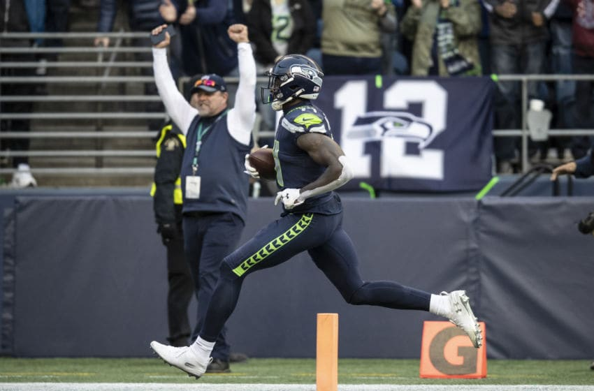 SEATTLE, WA - NOVEMBER 3: Wide receiver DK Metcalf #14 of the Seattle Seahawks scores a touchdown during the second half of a game against the Tampa Bay Buccaneers at CenturyLink Field on November 3, 2019 in Seattle, Washington. The Seahawks won 40-34 in overtime. (Photo by Stephen Brashear/Getty Images)