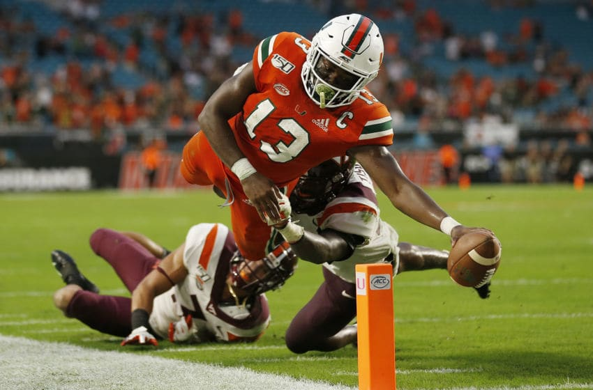 MIAMI, FLORIDA - OCTOBER 05: DeeJay Dallas #13 of the Miami Hurricanes dives to the pylon to score on a two-point conversion against the Virginia Tech Hokies during the second half at Hard Rock Stadium on October 05, 2019 in Miami, Florida. (Photo by Michael Reaves/Getty Images)