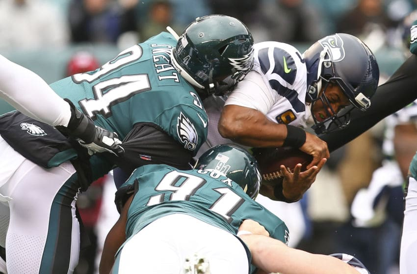 PHILADELPHIA, PA - NOVEMBER 24: Josh Sweat #94 of the Philadelphia Eagles sacks Russell Wilson #3 of the Seattle Seahawks in the first quarter at Lincoln Financial Field on November 24, 2019 in Philadelphia, Pennsylvania. The Seahawks defeated the Eagles 17-9. (Photo by Mitchell Leff/Getty Images)