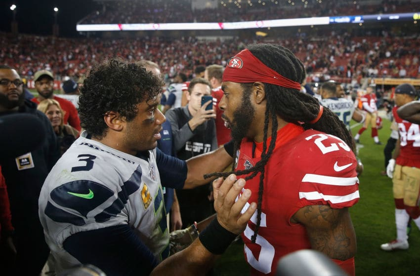 SANTA CLARA, CALIFORNIA - NOVEMBER 11: Russell Wilson #3 of the Seattle Seahawks and Richard Sherman #25 of the San Francisco 49ers chat after the game at Levi's Stadium on November 11, 2019 in Santa Clara, California. (Photo by Lachlan Cunningham/Getty Images)