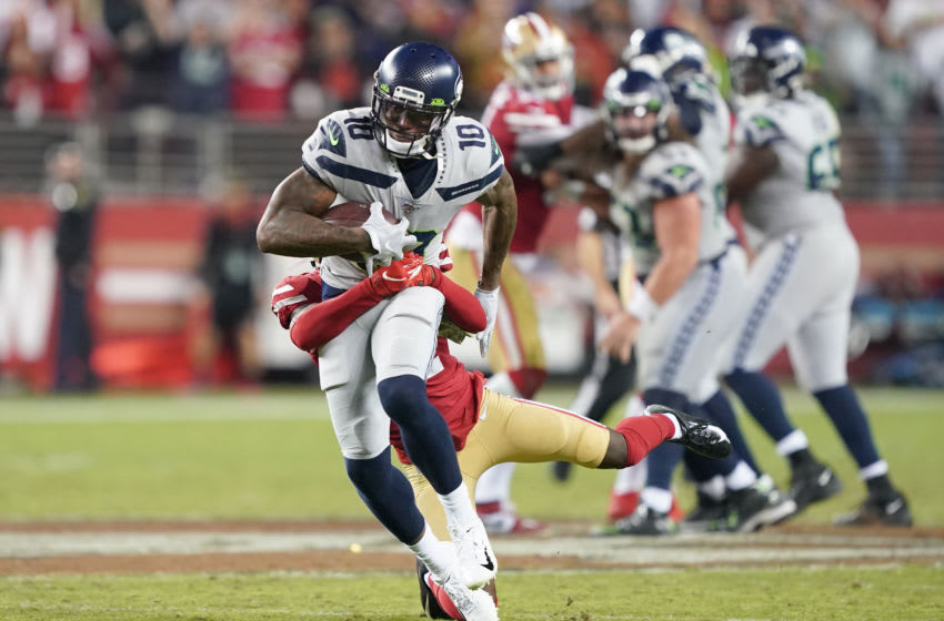 SANTA CLARA, CALIFORNIA - NOVEMBER 11: Wide receiver Josh Gordon #10 of the Seattle Seahawks is tackled by the defense of the San Francisco 49ers in the game at Levi's Stadium on November 11, 2019 in Santa Clara, California. (Photo by Thearon W. Henderson/Getty Images)