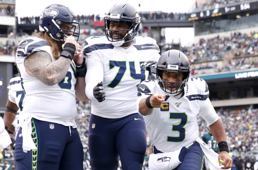 PHILADELPHIA, PENNSYLVANIA - NOVEMBER 24: Quarterback Russell Wilson #3 of the Seattle Seahawks celebrates in the end zone after throwing a first quarter touchdown pass against the Philadelphia Eagles at Lincoln Financial Field on November 24, 2019 in Philadelphia, Pennsylvania. (Photo by Elsa/Getty Images)