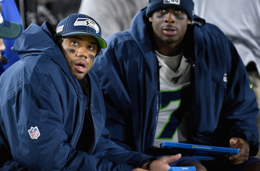 LOS ANGELES, CALIFORNIA - DECEMBER 08: Quarterbacks Russell Wilson #3 and Geno Smith #7 of the Seattle Seahawks look on from the bench during the game against the Los Angeles Rams at Los Angeles Memorial Coliseum on December 08, 2019 in Los Angeles, California. (Photo by Kevork Djansezian/Getty Images)