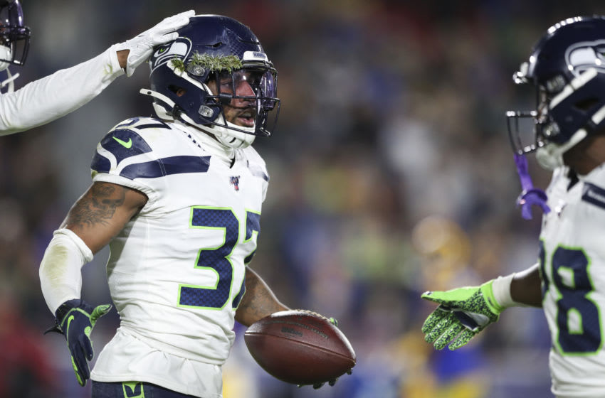 LOS ANGELES, CALIFORNIA - DECEMBER 08: Defensive back Quandre Diggs #37 of the Seattle Seahawks celebrates after intercepting a pass in the third quarter of the game against the Los Angeles Rams at Los Angeles Memorial Coliseum on December 08, 2019 in Los Angeles, California. (Photo by Meg Oliphant/Getty Images)