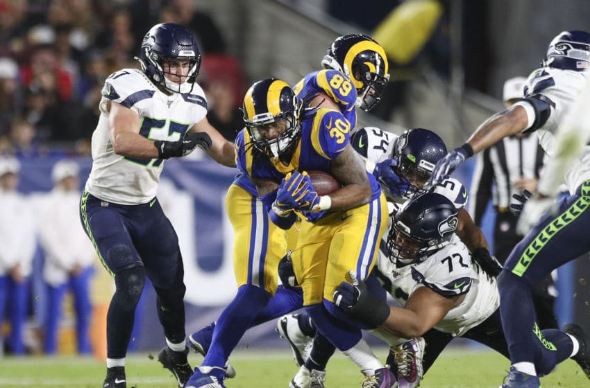 LOS ANGELES, CALIFORNIA - DECEMBER 08: Running back Todd Gurley #30 of the Los Angeles Rams carries the ball against the Seattle Seahawks in the third quarter at Los Angeles Memorial Coliseum on December 08, 2019 in Los Angeles, California. (Photo by Meg Oliphant/Getty Images)