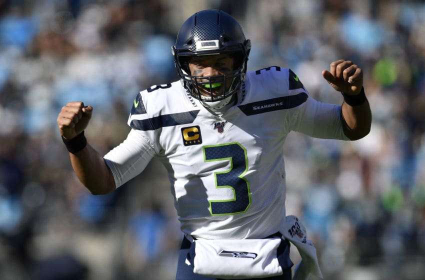 CHARLOTTE, NORTH CAROLINA - DECEMBER 15: Seattle Seahawks quarterback Russell Wilson #3 reacts to throwing a touchdown pass against Carolina Panthers in the first quarter at Bank of America Stadium on December 15, 2019 in Charlotte, North Carolina. (Photo by Grant Halverson/Getty Images)