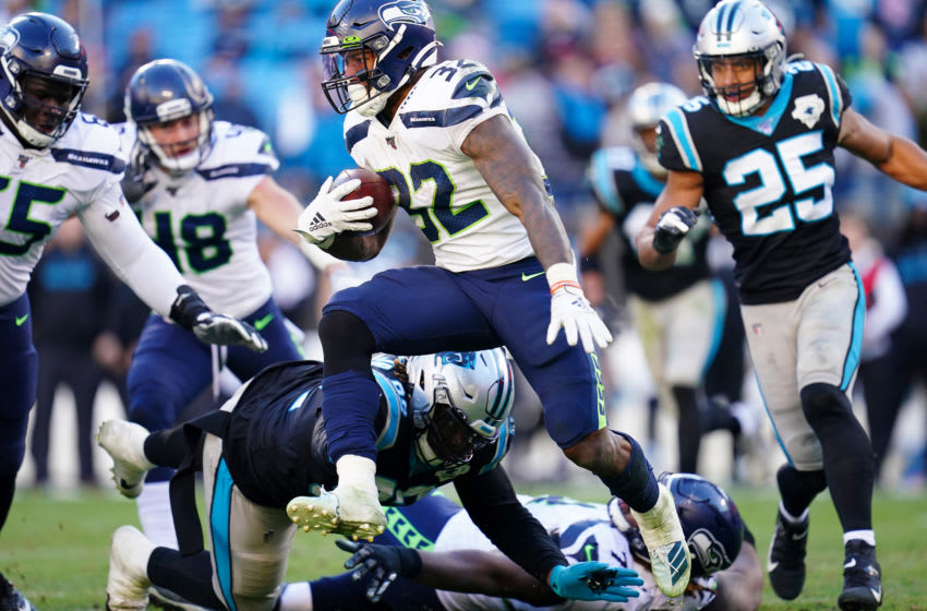 CHARLOTTE, NORTH CAROLINA - DECEMBER 15: Chris Carson #32 of the Seattle Seahawks during the second half during their game against the Carolina Panthers at Bank of America Stadium on December 15, 2019 in Charlotte, North Carolina. (Photo by Jacob Kupferman/Getty Images)