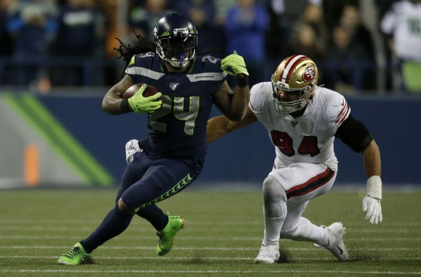 SEATTLE, WASHINGTON - DECEMBER 29: Running back Marshawn Lynch #24 of the Seattle Seahawks runs the ball against defensive end Solomon Thomas #94 of the San Francisco 49ers during the game at CenturyLink Field on December 29, 2019 in Seattle, Washington. (Photo by Otto Greule Jr/Getty Images)