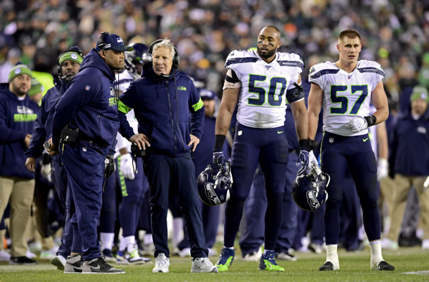 PHILADELPHIA, PENNSYLVANIA - JANUARY 05: Head coach Pete Carroll of the Seattle Seahawks speaks with defensive coordinator Ken Norton Jr. during a timeout against the Philadelphia Eagles in the NFC Wild Card Playoff game at Lincoln Financial Field on January 05, 2020 in Philadelphia, Pennsylvania. (Photo by Steven Ryan/Getty Images)