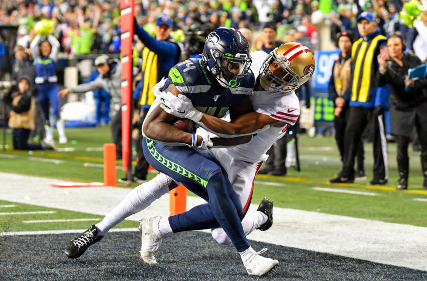 SEATTLE, WASHINGTON - DECEMBER 29: D.K. Metcalf #14 of the Seattle Seahawks scores on a 14 yard touchdown pass from Russell Wilson during the fourth quarter of the game against the San Francisco 49ers at CenturyLink Field on December 29, 2019 in Seattle, Washington. The San Francisco 49ers top the Seattle Seahawks 26-21. (Photo by Alika Jenner/Getty Images)