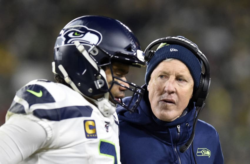 GREEN BAY, WISCONSIN - JANUARY 12: Quarterback Russell Wilson #3 of the Seattle Seahawks talks with head coach Pete Carroll as they take on the Green Bay Packers in the NFC Divisional Playoff game at Lambeau Field on January 12, 2020 in Green Bay, Wisconsin. (Photo by Quinn Harris/Getty Images)