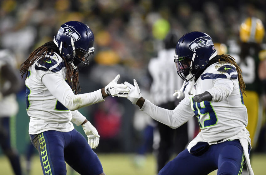 GREEN BAY, WISCONSIN - JANUARY 12: Shaquill Griffin #26 and Shaquem Griffin #49 of the Seattle Seahawks celebrate after sacking Aaron Rodgers #12 (not pictured) of the Green Bay Packers in the second half of the NFC Divisional Playoff game at Lambeau Field on January 12, 2020 in Green Bay, Wisconsin. (Photo by Quinn Harris/Getty Images)