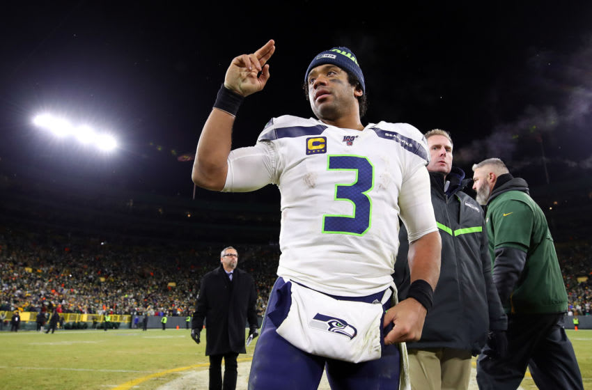 GREEN BAY, WISCONSIN - JANUARY 12: Russell Wilson #3 of the Seattle Seahawks reacts on the field after being defeated by the Green Bay Packers 28-23 in the NFC Divisional Playoff game at Lambeau Field on January 12, 2020 in Green Bay, Wisconsin. (Photo by Gregory Shamus/Getty Images)