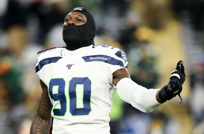 GREEN BAY, WISCONSIN - JANUARY 12: Jadeveon Clowney #90 of the Seattle Seahawks warms up before the NFC Divisional Round Playoff game against the Green Bay Packers at Lambeau Field on January 12, 2020 in Green Bay, Wisconsin. (Photo by Dylan Buell/Getty Images)