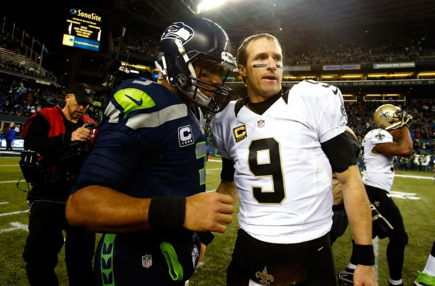 SEATTLE, WA - DECEMBER 02: Quarterback Russell Wilson #3 of the Seattle Seahawks and quarterback Drew Brees #9 of the New Orleans Saints meet on the field after the Seattle Seahawks defeated the New Orleans Saints 34-7 in a game at CenturyLink Field on December 2, 2013 in Seattle, Washington. (Photo by Jonathan Ferrey/Getty Images)