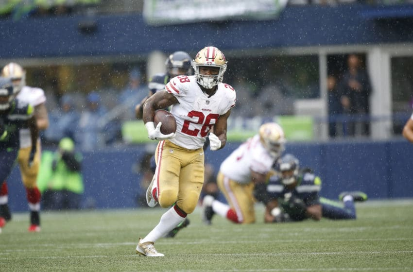 SEATTLE, CA - SEPTEMBER 17: Carlos Hyde #28 of the San Francisco 49ers rushes for a 61-yard gain during the game against the Seattle Seahawks at CenturyLink Field on September 17, 2017 in Seattle, Washington. The Seahawks defeated the 49ers 12-9. (Photo by Michael Zagaris/San Francisco 49ers/Getty Images)