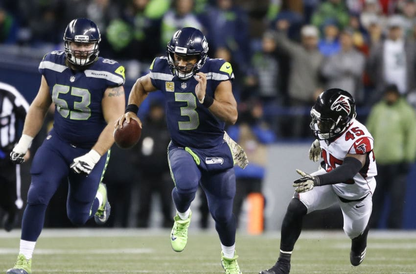 SEATTLE, WA - NOVEMBER 20: Quarterback Russell Wilson #3 of the Seattle Seahawks rushes against the Atlanta Falcons during the game at CenturyLink Field on November 20, 2017 in Seattle, Washington. (Photo by Otto Greule Jr /Getty Images)