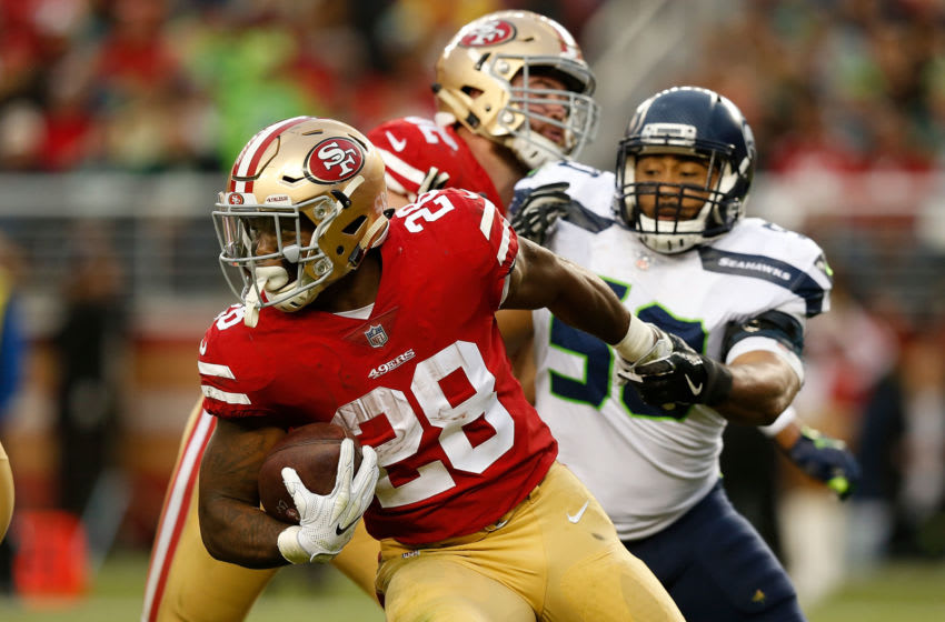 SANTA CLARA, CA - NOVEMBER 26: Carlos Hyde #28 of the San Francisco 49ers is tackled by K.J. Wright #50 of the Seattle Seahawks at Levi's Stadium on November 26, 2017 in Santa Clara, California. (Photo by Lachlan Cunningham/Getty Images)