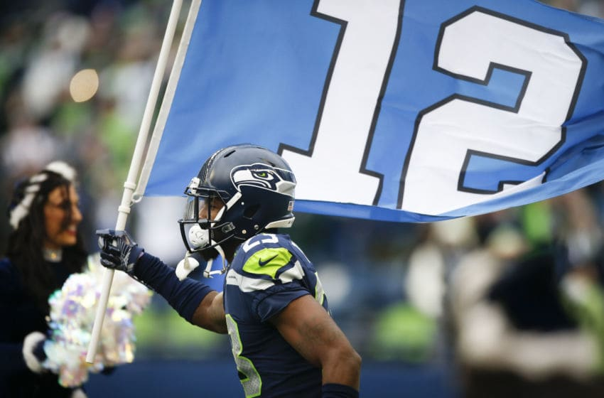 SEATTLE, WA - DECEMBER 17: Cornerback Neiko Thorpe #23 of the Seattle Seahawks runs the 12 flag onto the field during introductions the before the game against the Los Angeles Rams at CenturyLink Field on December 17, 2017 in Seattle, Washington. (Photo by Otto Greule Jr /Getty Images)