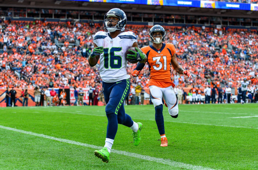 DENVER, CO - SEPTEMBER 9: Wide receiver Tyler Lockett #16 of the Seattle Seahawks scores a fourth quarter touchdown under coverage by defensive back Justin Simmons #31 of the Denver Broncos at Broncos Stadium at Mile High on September 9, 2018 in Denver, Colorado. (Photo by Dustin Bradford/Getty Images)