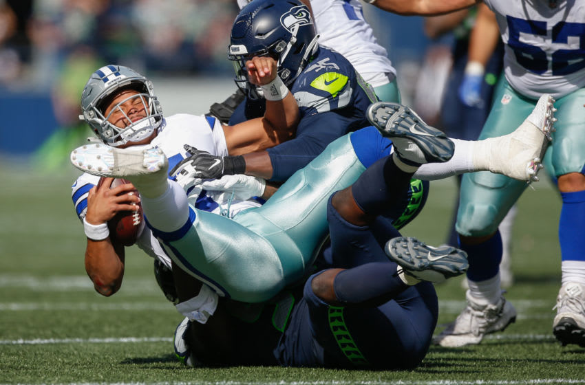 SEATTLE, WA - SEPTEMBER 23: Quarterback Dak Prescott #4 of the Dallas Cowboys is sacked by defensive end Dion Jordan #95 of the Seattle Seahawks at CenturyLink Field on September 23, 2018 in Seattle, Washington. (Photo by Otto Greule Jr/Getty Images)