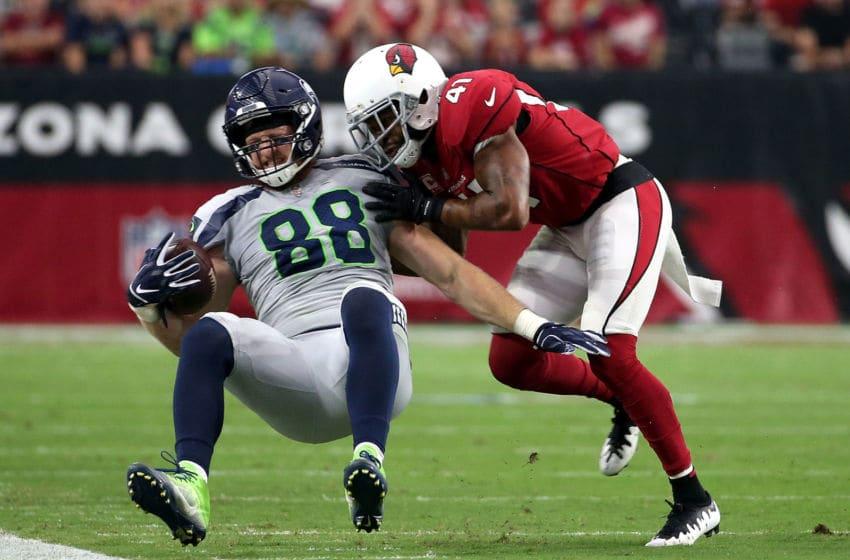 GLENDALE, AZ - SEPTEMBER 30: Defensive back Antoine Bethea #41 of the Arizona Cardinals hits tight end Will Dissly #88 of the Seattle Seahawks during the second quarter at State Farm Stadium on September 30, 2018 in Glendale, Arizona. (Photo by Ralph Freso/Getty Images)