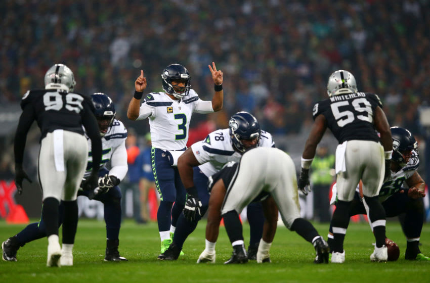 LONDON, ENGLAND - OCTOBER 14: Russell Wilson #3 of the Seattle Seahawks signals during the NFL International Series game between Seattle Seahawks and Oakland Raiders at Wembley Stadium on October 14, 2018 in London, England. (Photo by Dan Istitene/Getty Images)