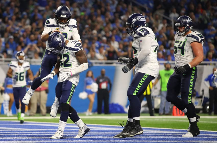 DETROIT, MI - OCTOBER 28: Quarterback Russell Wilson #3 of the Seattle Seahawks jumps on the back of Chris Carson #32 to celebrate Carson's touchdown during the fourth quarter against the Detroit Lions at Ford Field on October 28, 2018 in Detroit, Michigan. (Photo by Gregory Shamus/Getty Images)