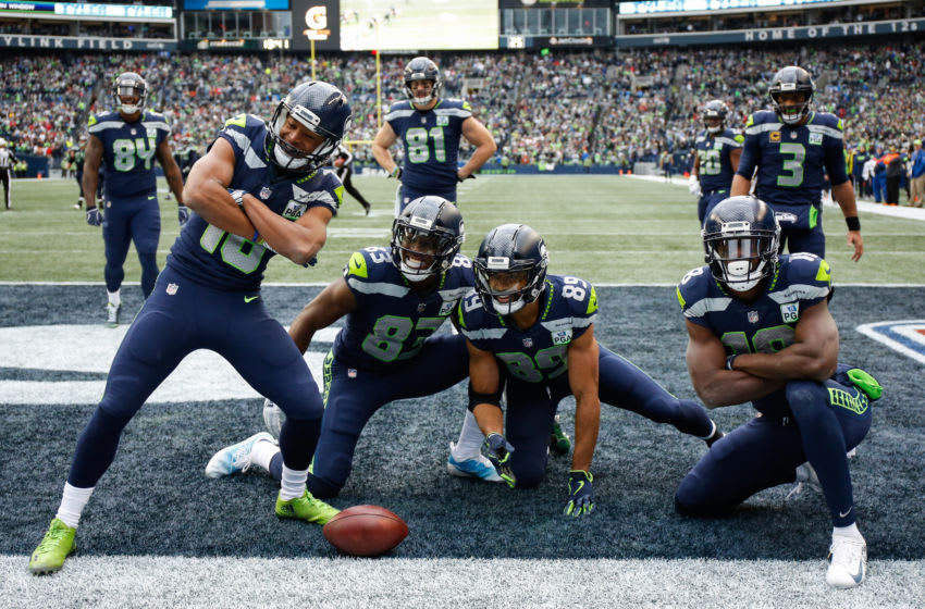 SEATTLE, WA - DECEMBER 02: Tyler Lockett #16 of the Seattle Seahawks celebrates a second quarter touchdown with teammates in the game against the San Francisco 49ers at CenturyLink Field on December 2, 2018 in Seattle, Washington. (Photo by Otto Greule Jr/Getty Images)