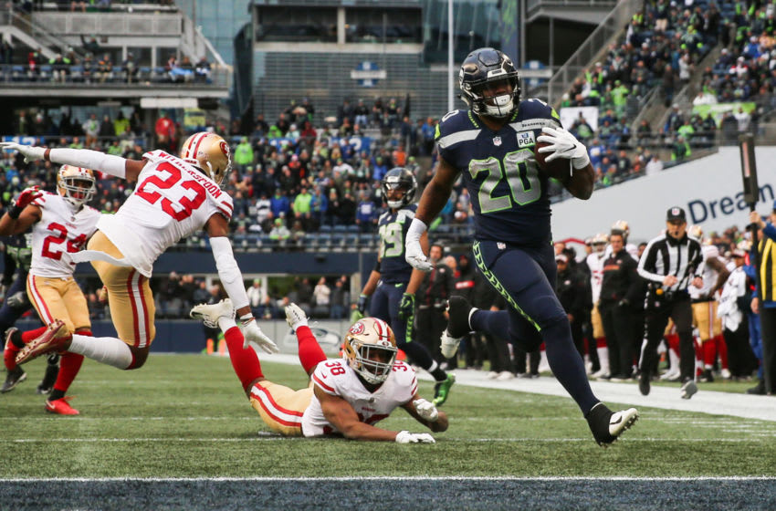 SEATTLE, WA - DECEMBER 02: Rashaad Penny #20 of the Seattle Seahawks avoids a tackle by Antone Exum #38 of the San Francisco 49ers for a touchdown in the third quarter at CenturyLink Field on December 2, 2018 in Seattle, Washington. (Photo by Abbie Parr/Getty Images)