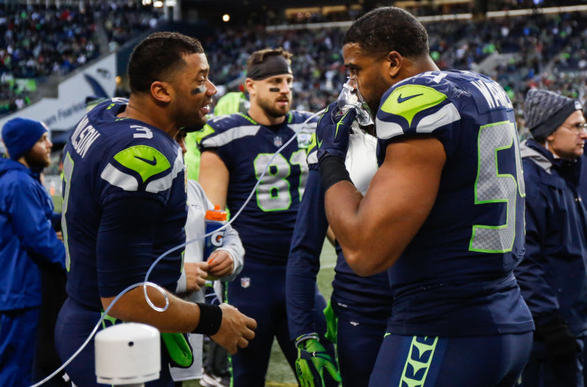 SEATTLE, WA - DECEMBER 02: Bobby Wagner #54 of the Seattle Seahawks celebrates with Russell Wilson #3 after an interception return for a touchdown in the fourth quarter against the San Francisco 49ers at CenturyLink Field on December 2, 2018 in Seattle, Washington. (Photo by Otto Greule Jr/Getty Images)