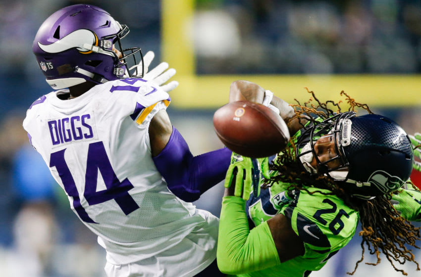 SEATTLE, WA - DECEMBER 10: Shaquill Griffin #26 of the Seattle Seahawks breaks up a catch by Stefon Diggs #14 of the Minnesota Vikings in the fourth quarter at CenturyLink Field on December 10, 2018 in Seattle, Washington. (Photo by Otto Greule Jr/Getty Images)