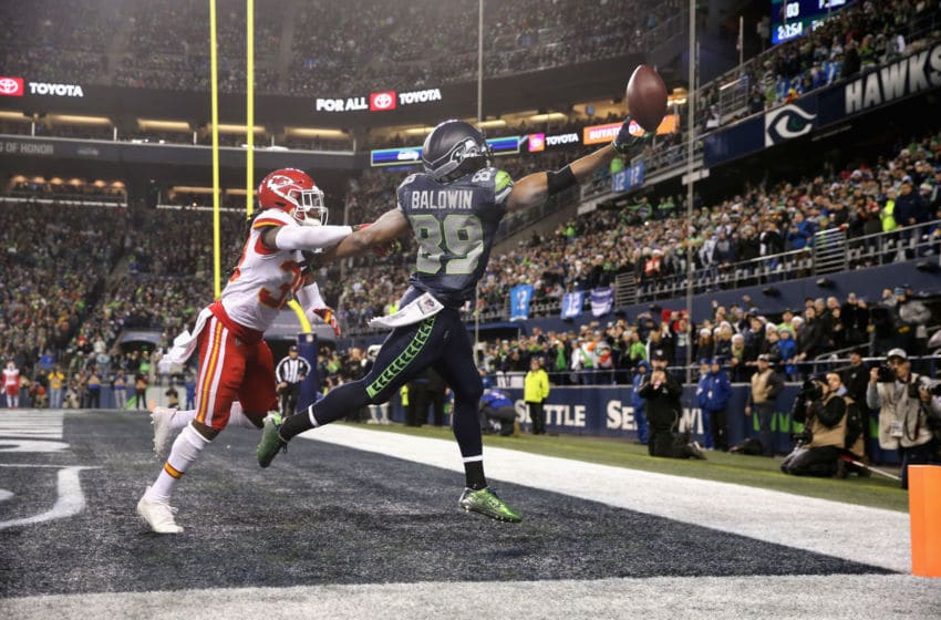 SEATTLE, WA - DECEMBER 23: Doug Baldwin #89 of the Seattle Seahawks reaches for an incomplete pass in front of Tremon Smith #39 of the Kansas City Chiefs during the fourth quarter of the game at CenturyLink Field on December 23, 2018 in Seattle, Washington. (Photo by Abbie Parr/Getty Images)