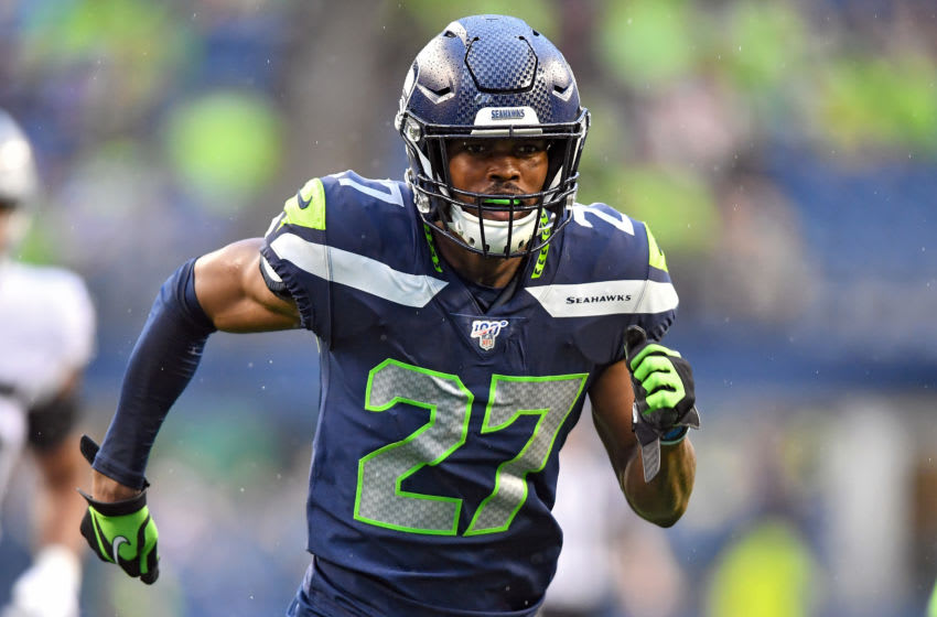 SEATTLE, WASHINGTON - AUGUST 29: Marquise Blair #27 of the Seattle Seahawks runs down on kick-off coverage during the preseason game against the Oakland Raiders at CenturyLink Field on August 29, 2019 in Seattle, Washington. (Photo by Alika Jenner/Getty Images)