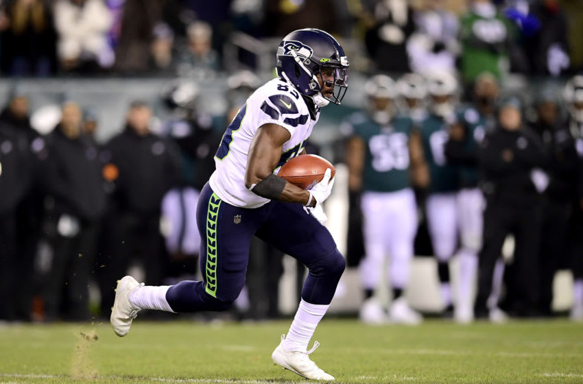 PHILADELPHIA, PENNSYLVANIA - JANUARY 05: David Moore #83 of the Seattle Seahawks runs the ball against the Philadelphia Eagles in the NFC Wild Card Playoff game at Lincoln Financial Field on January 05, 2020 in Philadelphia, Pennsylvania. (Photo by Steven Ryan/Getty Images)