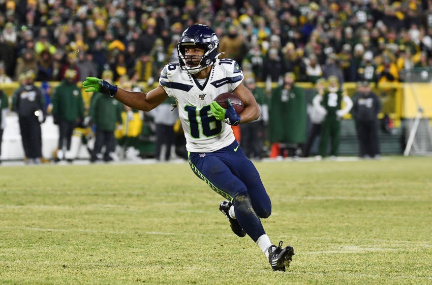 GREEN BAY, WISCONSIN - JANUARY 12: Tyler Lockett #16 of the Seattle Seahawks runs for yards during the NFC Divisional Playoff game against the Green Bay Packers at Lambeau Field on January 12, 2020 in Green Bay, Wisconsin. (Photo by Stacy Revere/Getty Images)