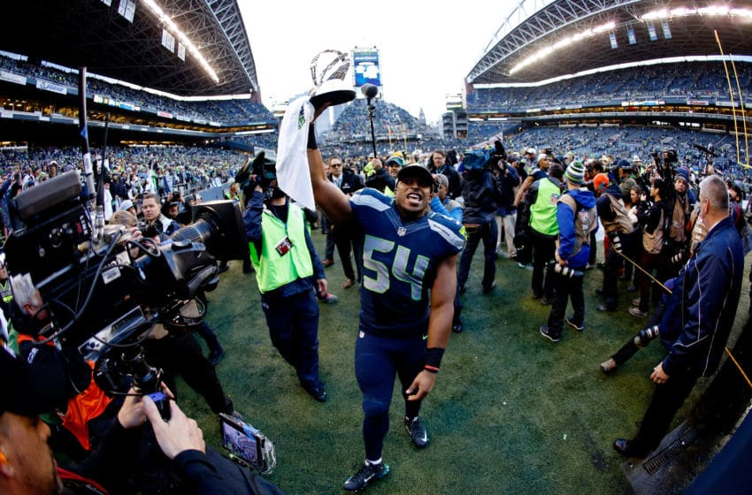 SEATTLE, WA - JANUARY 18: Bobby Wagner #54 of the Seattle Seahawks holds up the George S. Halas trophy as he walks off the field after the Seahawks defeated the Green Bay Packers in the 2015 NFC Championship game at CenturyLink Field on January 18, 2015 in Seattle, Washington. (Photo by Otto Greule Jr/Getty Images)