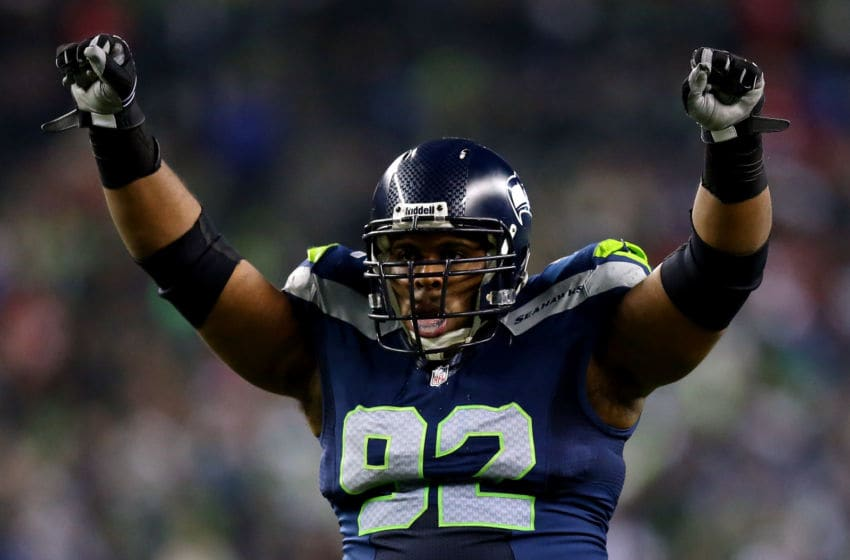 SEATTLE, WA - JANUARY 19: Defensive tackle Brandon Mebane #92 of the Seattle Seahawks celebrates in the fourth quarter while taking on the San Francisco 49ers during the 2014 NFC Championship at CenturyLink Field on January 19, 2014 in Seattle, Washington. (Photo by Ronald Martinez/Getty Images)