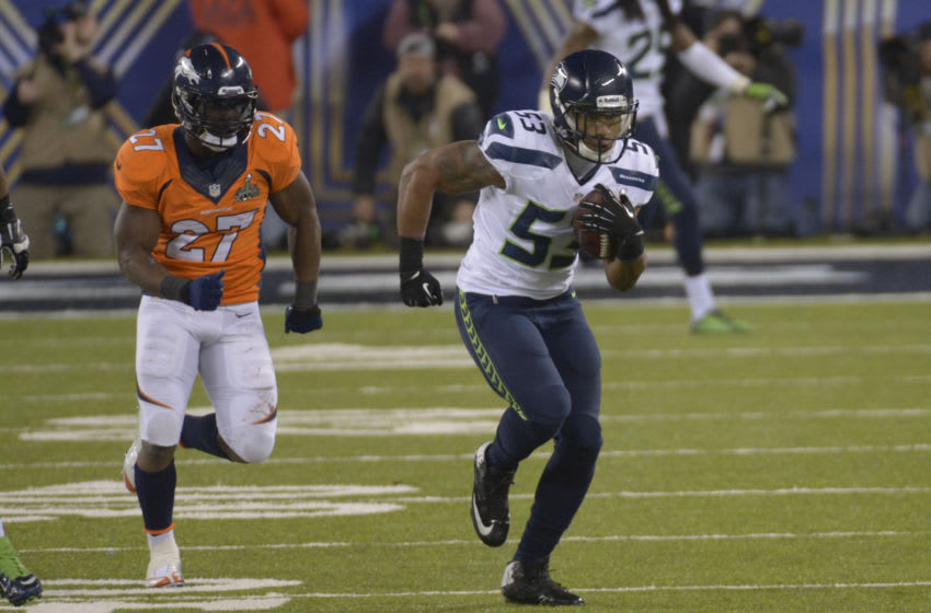 EAST RUTHERFORD, NJ - FEBRUARY 02: Malcolm Smith #53 of the Seattle Seahawks intercepts a pass and runs it back sixty nine yards for a touchdown against the Denver Broncos during Super Bowl XLVIII on February 2, 2014 at MetLife Stadium in East Rutherford, New Jersey. The Seahawks won the game 43-8. (Photo by Focus on Sport/Getty Images)