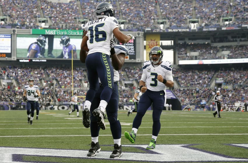 BALTIMORE, MD - DECEMBER 13: Wide receiver Tyler Lockett #16 of the Seattle Seahawks celebrates with teammates defensive end Frank Clark #55 and quarterback Russell Wilson #3 after scoring a first quarter touchdown against the Baltimore Ravens at M&T Bank Stadium on December 13, 2015 in Baltimore, Maryland. (Photo by Rob Carr/Getty Images)