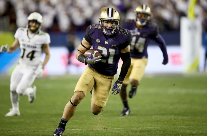 SANTA CLARA, CA - DECEMBER 02: Taylor Rapp #21 of the Washington Huskies runs back an interception during their game against the Colorado Buffaloes in the Pac-12 Championship game at Levi's Stadium on December 2, 2016 in Santa Clara, California. (Photo by Robert Reiners/Getty Images)