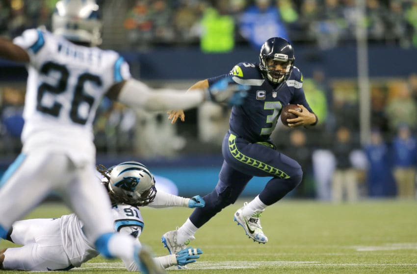 SEATTLE, WA - DECEMBER 04: Quarterback Russell Wilson #3 of the Seattle Seahawks rushes against the Carolina Panthers at CenturyLink Field on December 4, 2016 in Seattle, Washington. (Photo by Jonathan Ferrey/Getty Images)