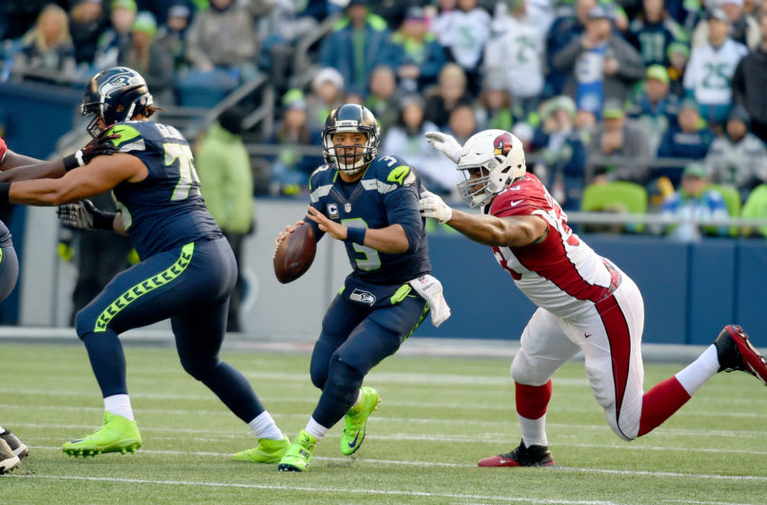 SEATTLE, WA - DECEMBER 24: Quarterback Russell Wilson #3 of the Seattle Seahawks passes against the Arizona Cardinals at CenturyLink Field on December 24, 2016 in Seattle, Washington. (Photo by Steve Dykes/Getty Images)