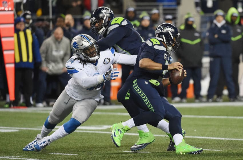 SEATTLE, WA - JANUARY 07: Ezekiel Ansah #94 of the Detroit Lions attempts to tackle Russell Wilson #3 of the Seattle Seahawks during the first half of the NFC Wild Card game at CenturyLink Field on January 7, 2017 in Seattle, Washington. (Photo by Steve Dykes/Getty Images)