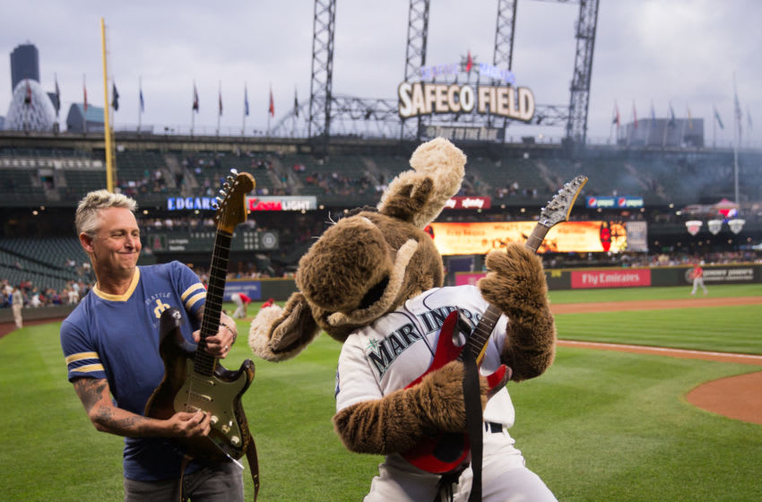 SEATTLE, WA - SEPTEMBER 08: Mike McCready of Pearl Jam poses with the Mariner Moose after performing the national anthem before the game between the Seattle Mariners and the Los Angeles Angels of Anaheim at Safeco Field on September 8, 2017 in Seattle, Washington. (Photo by Lindsey Wasson/Getty Images)