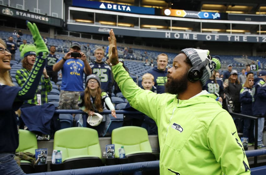 SEATTLE, WA - OCTOBER 29: Michael Bennett #72 of the Seattle Seahawks greets a fan before the game against the Houston Texans at CenturyLink Field on October 29, 2017 in Seattle, Washington. (Photo by Otto Greule Jr/Getty Images)