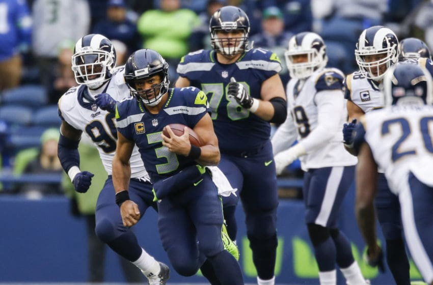 SEATTLE, WA - DECEMBER 17: Quarterback Russell Wilson #3 of the Seattle Seahawks rushes against the Los Angeles Rams during the third quarter of the game at CenturyLink Field on December 17, 2017 in Seattle, Washington. (Photo by Otto Greule Jr /Getty Images)