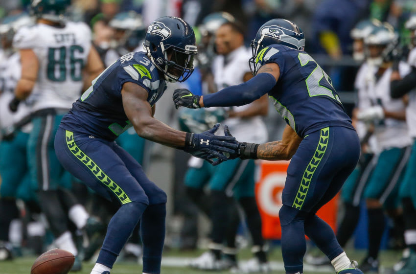 SEATTLE, WA - NOVEMBER 20: Safety Kam Chancellor #31 (L) of the Seattle Seahawks celebrates with free safety Earl Thomas #29 after intercepting a pass in the second quarter against the Philadelphia Eagles at CenturyLink Field on November 20, 2016 in Seattle, Washington. (Photo by Otto Greule Jr/Getty Images)